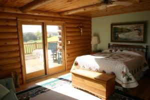 log_home_master_bedroom_bed